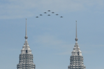 The Black Eagles, the aerobatic team of T-50 jets belonging to South Korea's air force, fly in formation past the Petronas Twin Towers during flypast in Kuala Lumpur on March 29, 2017. Picture by Seth Akmal