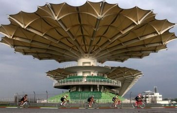 Cyclist are seen riding on the track of Formula One sepang as symbol of free car campaign organized by Sepang International Circuit in Sepang, Selangor on April 23,2015.-The Malaysian Insider pic by Seth Akmal