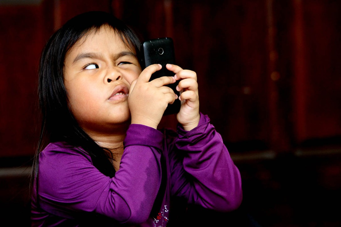 A blind girl is seen playing with a cellphone in Wisma Malaysian Association for the Blind , Brickfields , Kuala Lumpur on April 30,2015.-The Malaysian Insider pic by Seth Akmal.