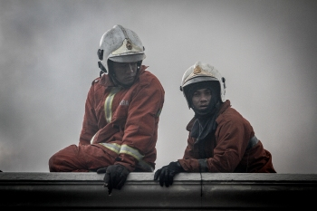 Two firefighters at the scene on the rooftop to extinguish the fire in Kuala Lumpur on February 13, 2016. The Malaysian Insider/Seth Akmal.