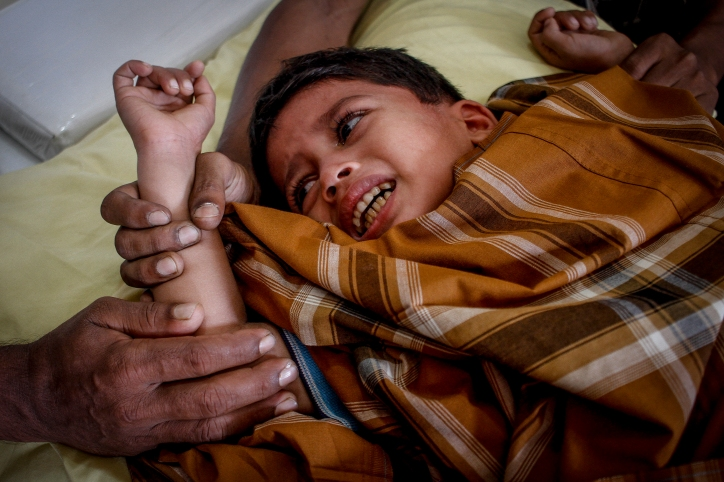 Rohingya children is seen crying while getting circumcised in Selayang, Selangor on April 3, 2016. Picture by Seth Akmal.