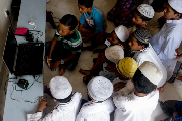 A group of Rohingya children watching a cartoon while waiting for their turn to circumcise in Selayang, Selangor on April 3, 2016. Picture by Seth Akmal.
