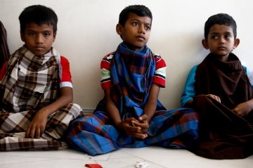 Three Rohingya children are waiting for their turn to circumcise in Selayang, Selangor on April 3, 2016. Picture by Seth Akmal.