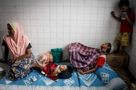Relatives accompanying the Rohingya boy while getting rest after circumcision in Selayang,Selangor on April 3, 2016. Picture by Seth Akmal.