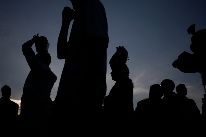A silhouette of hindu devotees carry milk pots during Thaipusam festival at Batu Caves on the outskirts of Kuala Lumpur on January 24, 2016. The Malaysian Insider/Seth Akmal.
