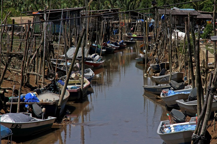 Fishing boats are seen stranded in coastal river, the main economy source of Kampung Pendas is the fishing industry in Kampung Pendas,Gelang Patah,Johor on March 12,2015.-The Malaysian Insider pic by Seth Akmal