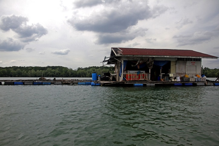 A Raft House owned by one Chinese fisherman remains empty after being affected by the surrounding in Kampung Pendas,Gelang Patah,Johor on March 12,2015.-The Malaysian Insider pic by Seth Akmal