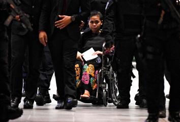 Indonesian suspect Siti Aisyah in a wheelchair as she backtracks through the events of February 13 at klia2 today. – The Malaysian Insight pic by Seth Akmal, October 24, 2017