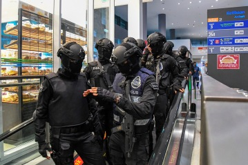 Special Task Force on Organised Crime personnel at the arrival hall in klia2 today. - The Malaysian Insight pic by Seth Akmal.